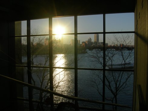 Sunrise reflecting off a building on the Charles River. Taken from the 2nd floor of the Museum of Science